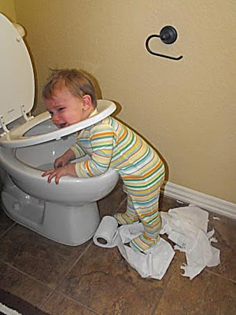 Funny picture of boy stuck in potty seat