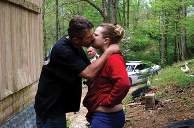 A man and a woman kissing