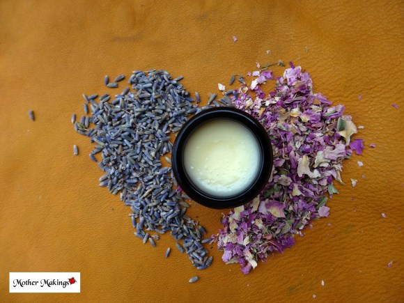 1oz Infused lavender Rose Tallowed Touch Tallow Balm open with a heart of dried rose and lavender petals and flowers.