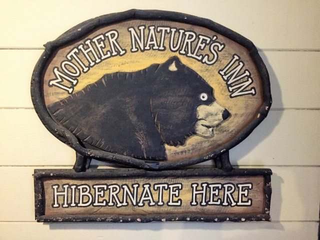 Mother Nature's Inn Hibernate Here sign