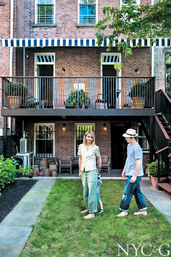 Rebecca Taylor brownstone yard with black and white striped balcony