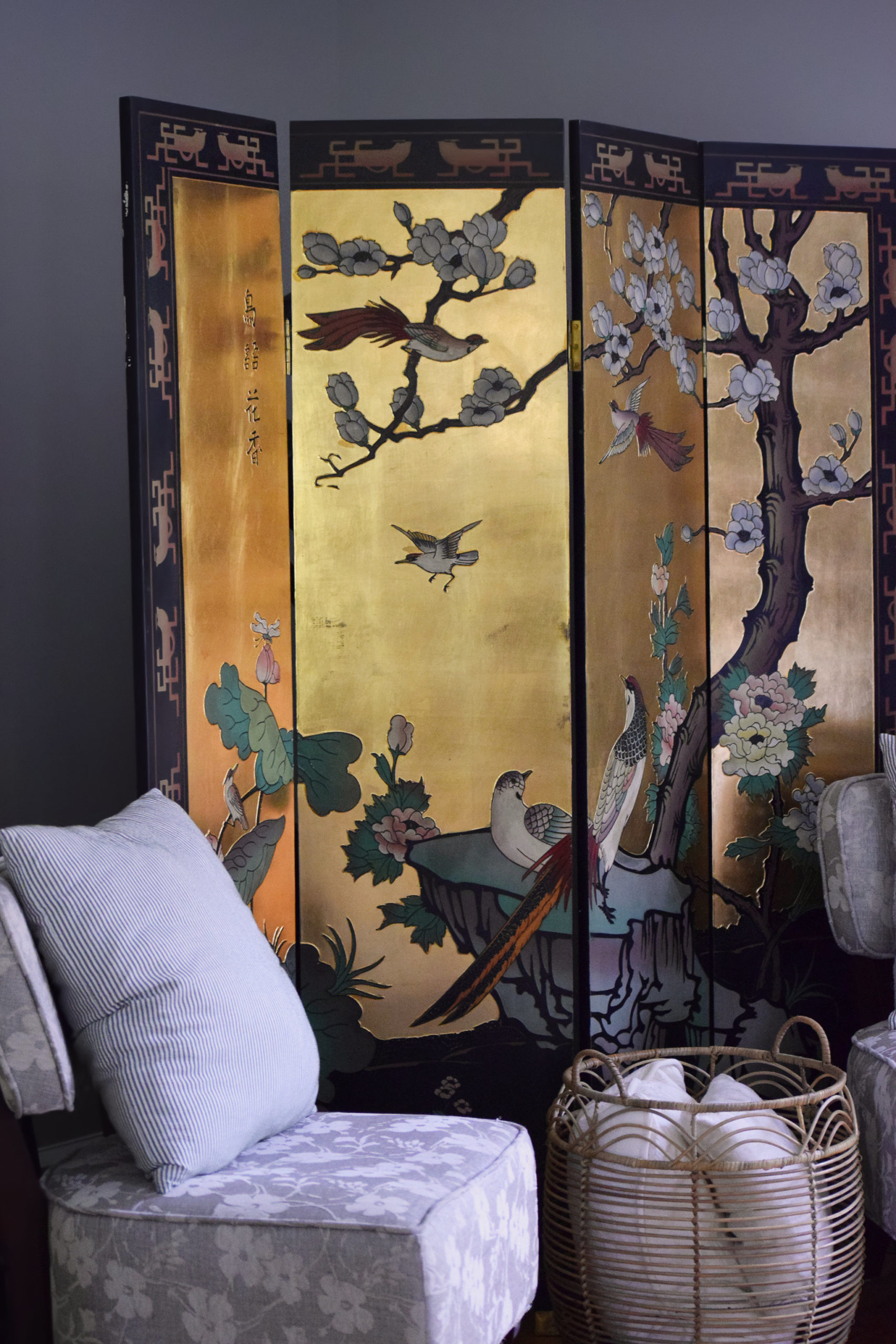 chinoiserie coromandel floor screen with chair and basket hiding our elliptical machine