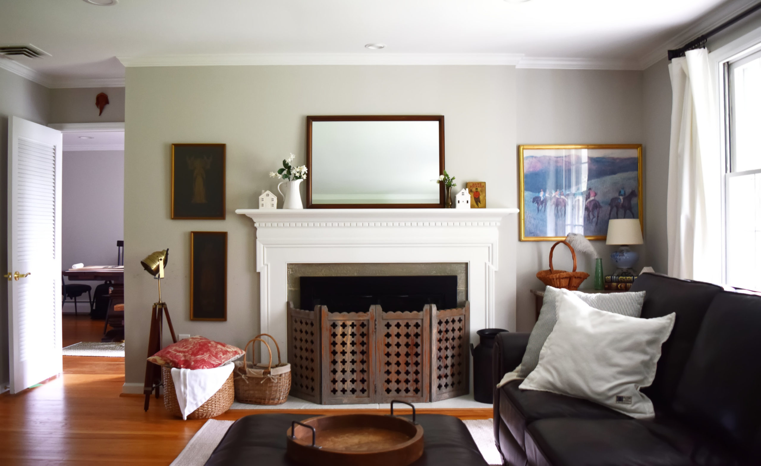 white fireplace mantel with mirror and book