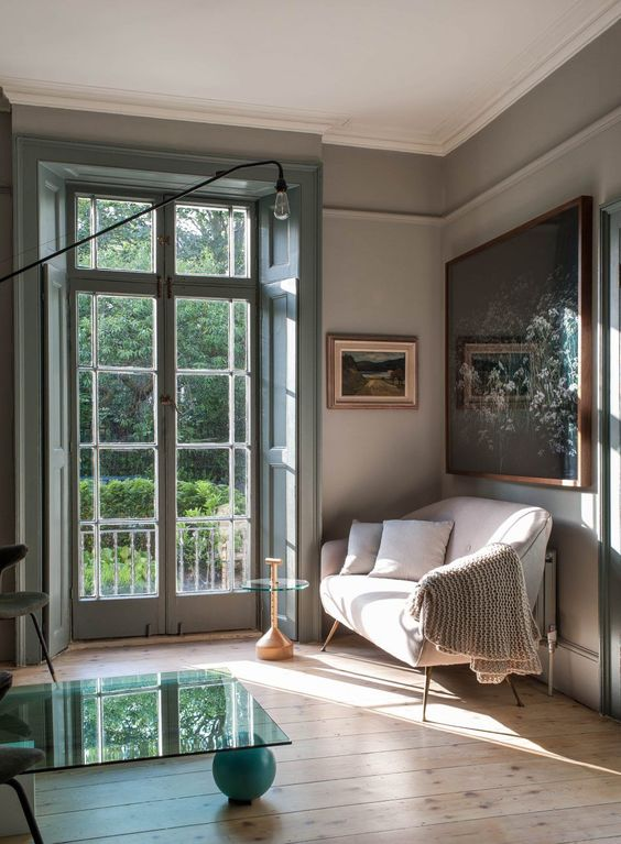 french-gray-living-room-with-green-accent-doors