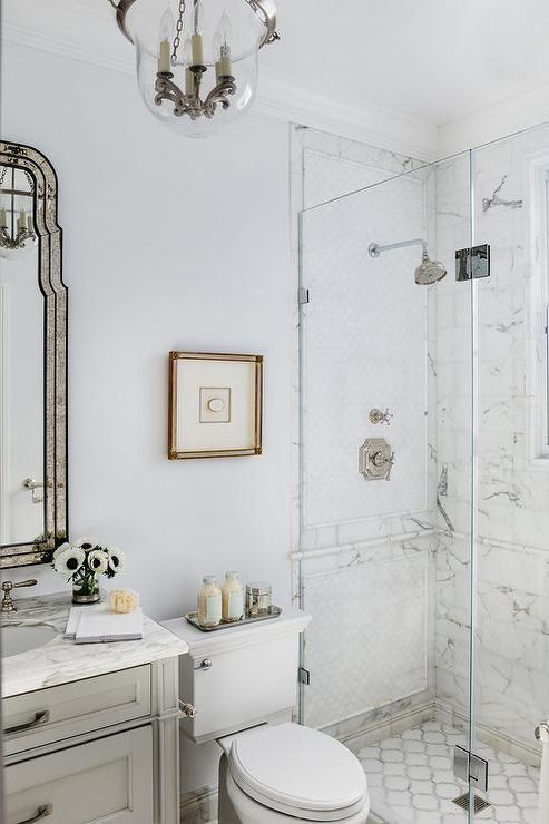 marble walk in shower in neoclassical bathroom