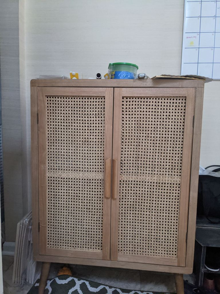 cane cabinet before