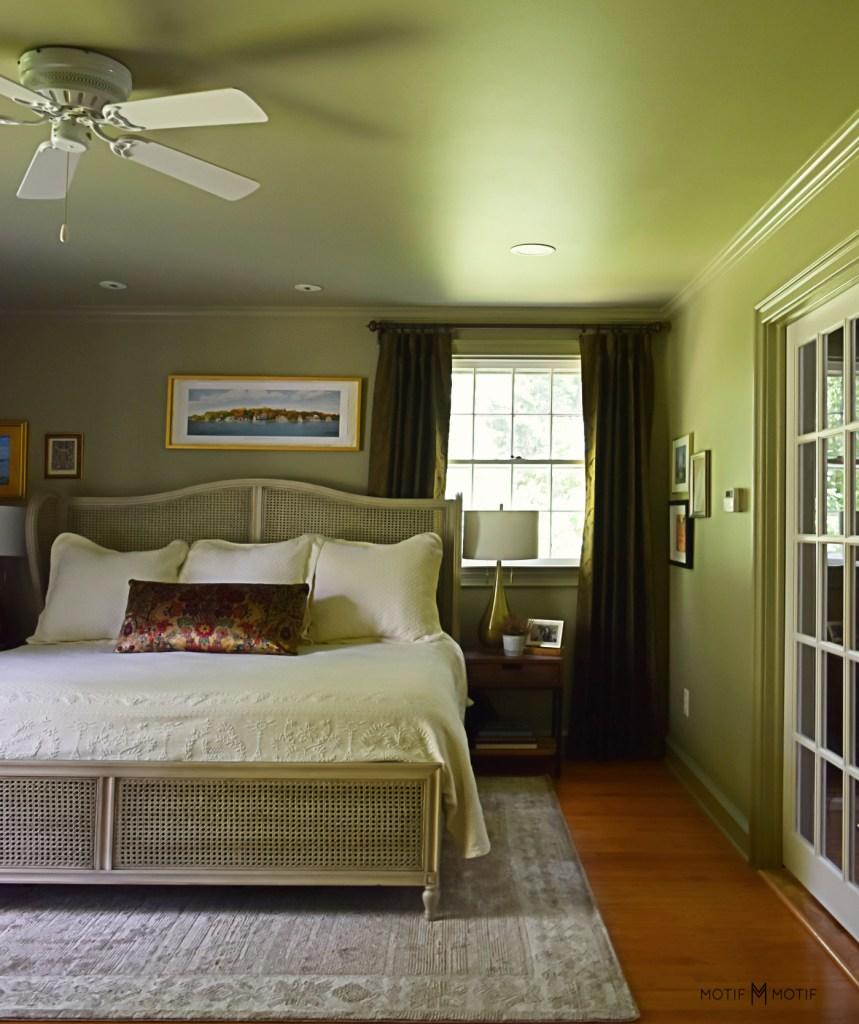 french pocket doors in french gray green bedroom