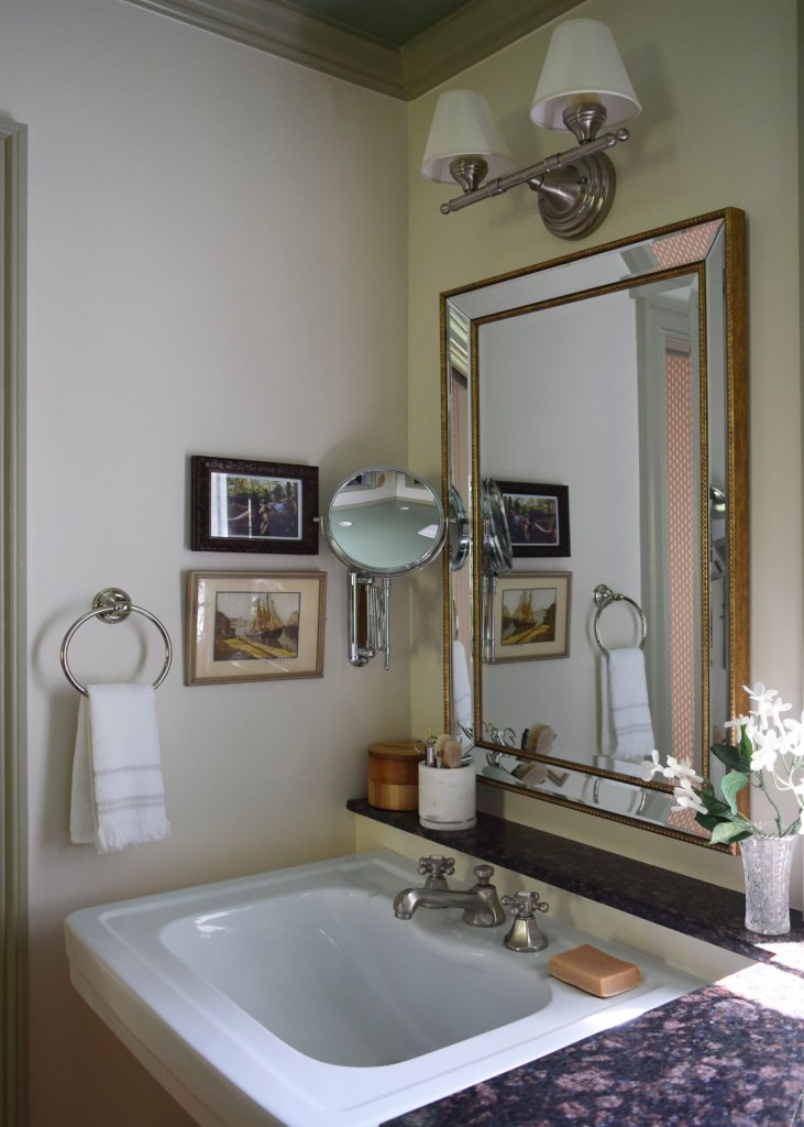 one room challenge pedestal sink vanity with gold bead mirror and accordion mirror