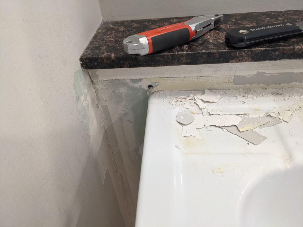 peeling drywall behind sink