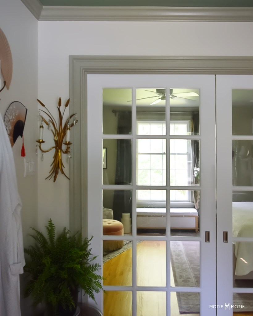 tole wheat sconce and chinese fans over fan next to pocket doors