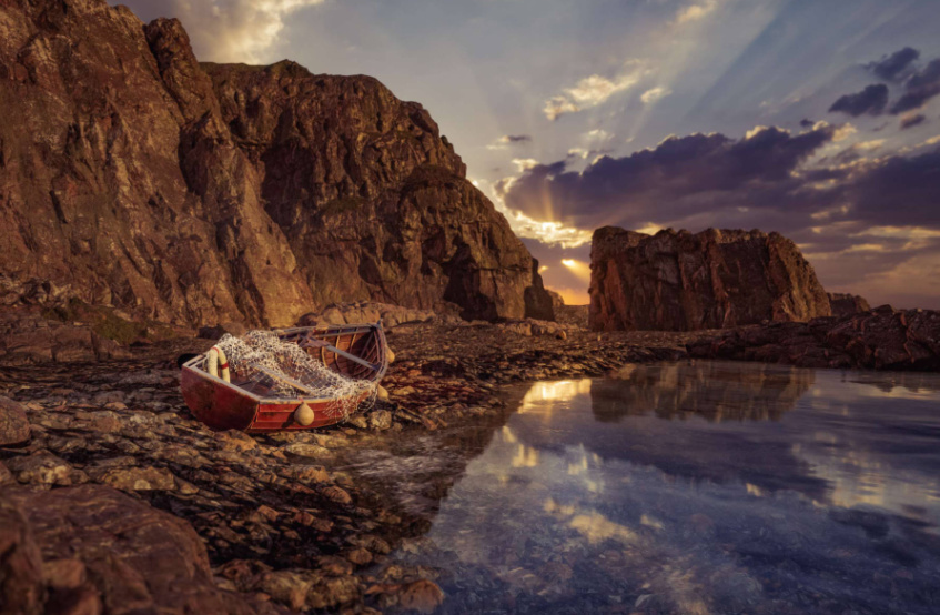 Fishing Boat on Rocky Shoreline