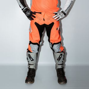 Front of adult orange engage motorsports pants