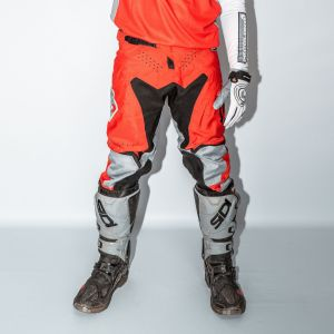 Front of adult red engage motorsports pants