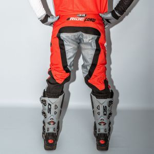 Back of adult red engage motorsports pants