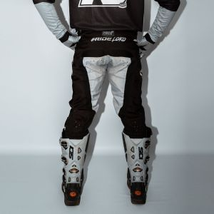 Back of adult black and grey engage motorsports pants