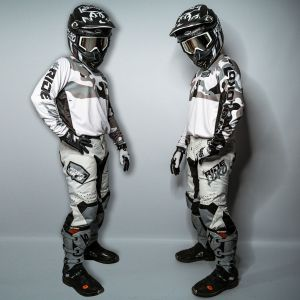 Both sides view of complete grey and white camo motocross kit