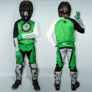 model wearing green born 2 race motorsports kit showing front & back views