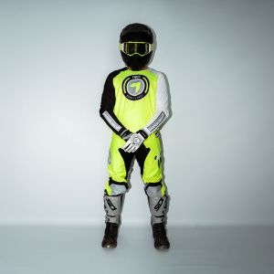 front view of model wearing yellow born 2 race motocross kit