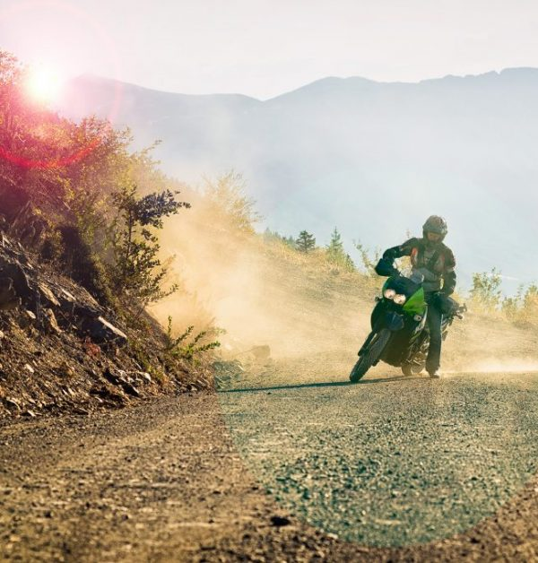 Motorcycle doing a burnout on a dirt road outside Whistler