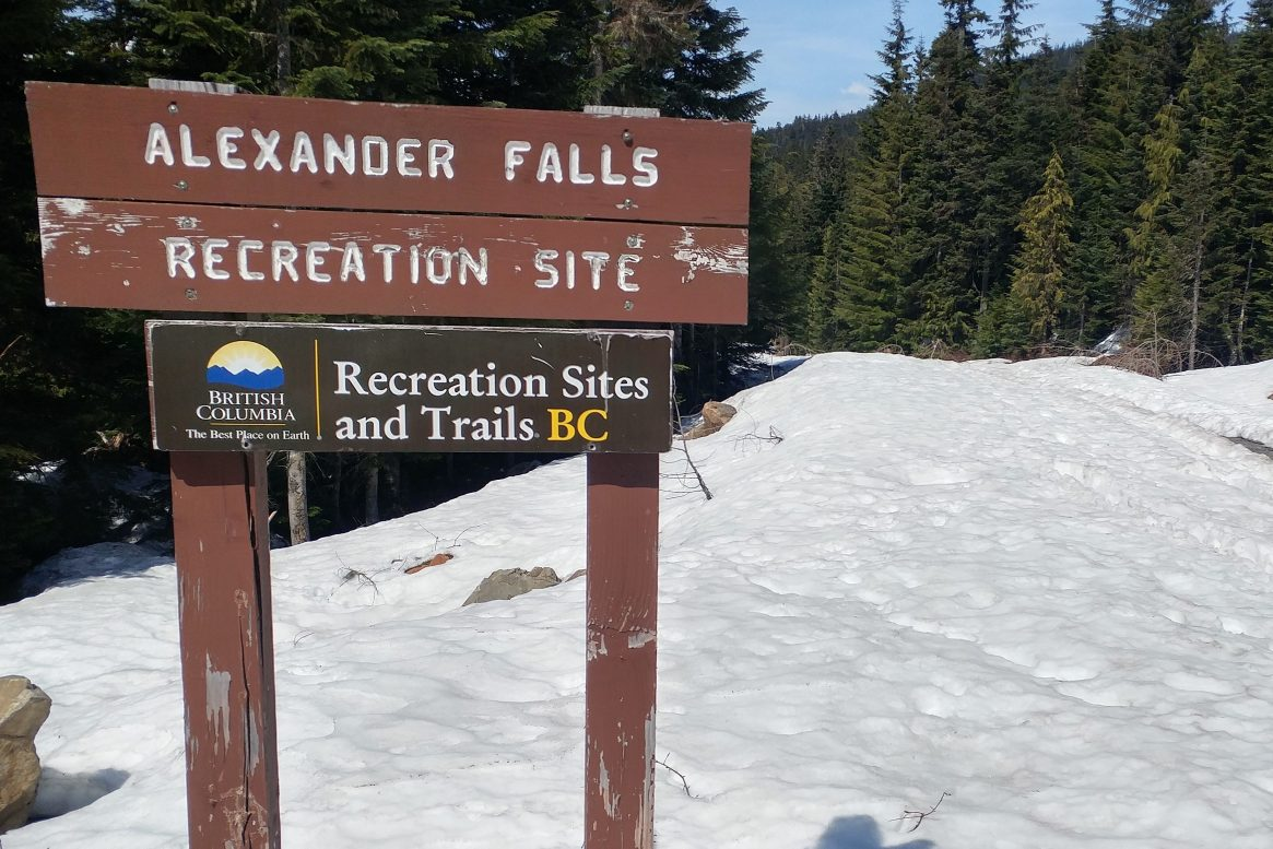 Alexander falls trail sign near whistler in spring with snow
