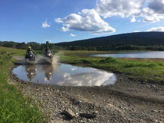 BMW splashing water in a farm field outside Pemberton