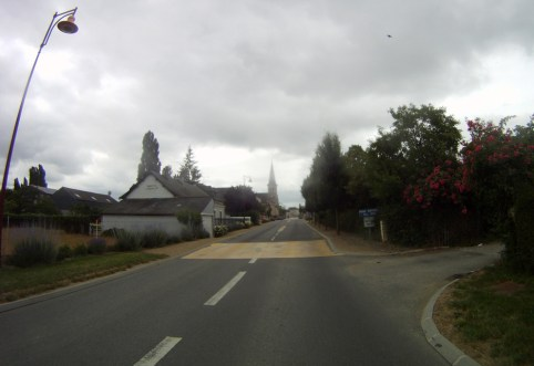 Dark skies hover over the old French village