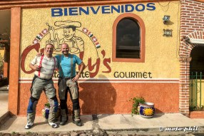 Charly from Charly's Restaurante and moto.phil posing for a picture in front of the restaurant