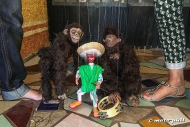 Two ape string puppets and a mexican string puppet