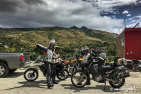 """GS riders """"Arrieros"""" posing with their bikes in front of Cerro del Cubilete"""