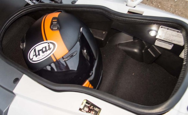 The Kymco holds two lids and has a light plus a power port.