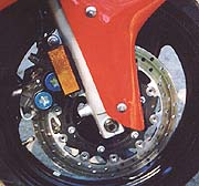 The stock Nissin calipers, pads and rotors on the YZF are the best OEM four-piston brakes we've ever tested.
