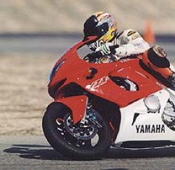 """Editor-in-Chief Plummer went fastest at the racetrack on the YZF: """"The YZF's excellent binders allow you to one-finger the front brakes and the torquey motor produces killer drives off corners."""""""