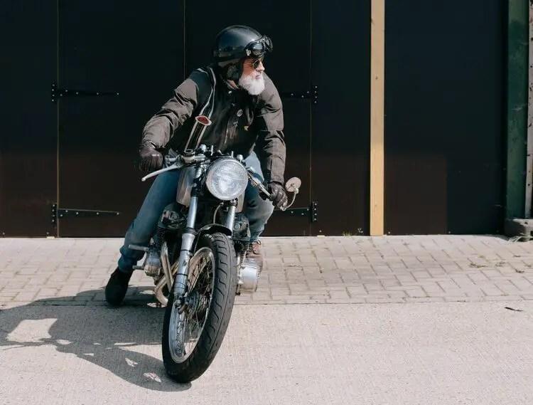 old rider on vintage bike - motorcycle travel