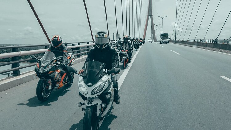 bikers on millau viaduct