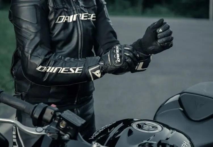 biker pulling on gloves