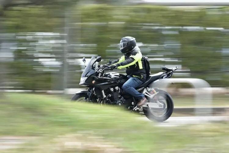 biker on honda wearing jeans