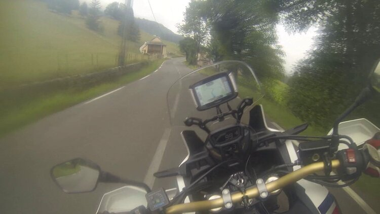 biker taking corners smoothly in the Pyrenees - wet weather motorcycle riding
