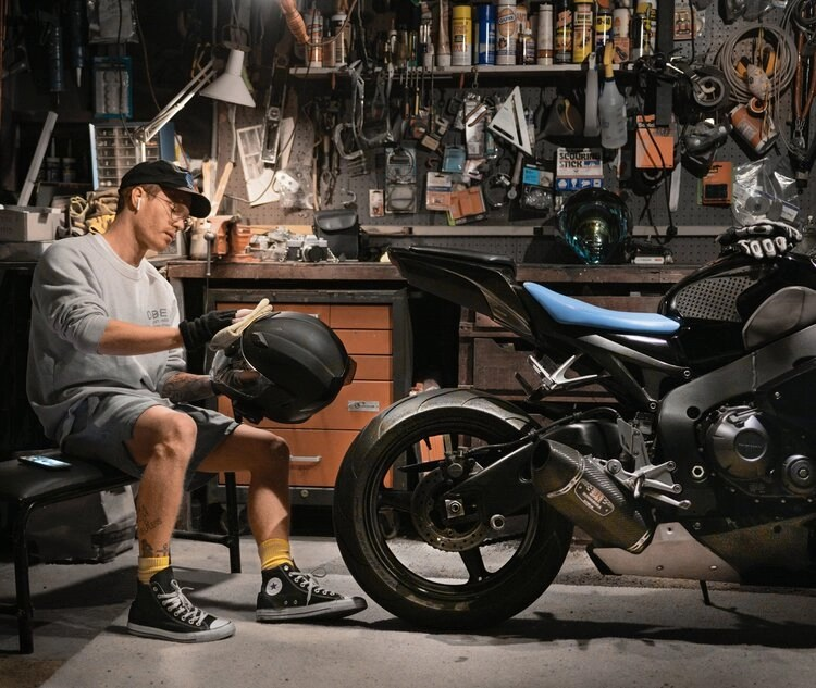 rider with motorcycle tools in garage