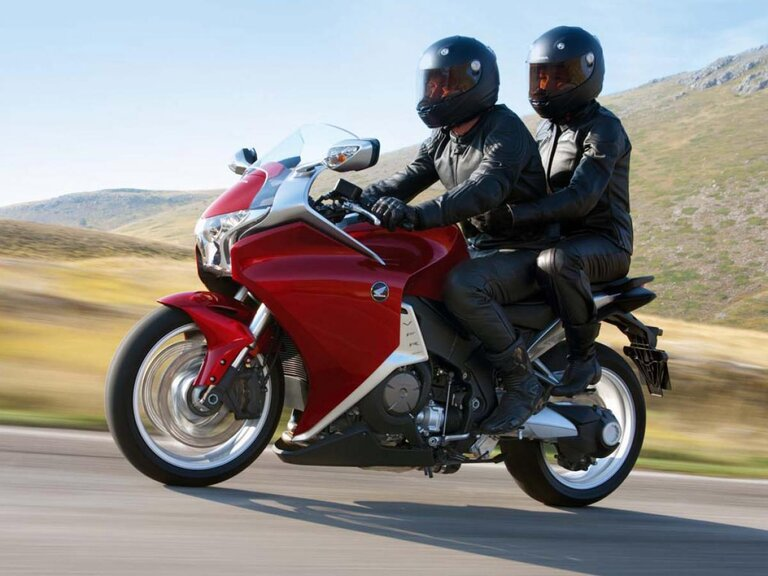 honda vfr 1200 with rider and passenger in mountains - touring with a pillion