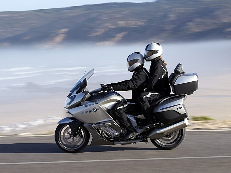rider and passenger on touring bmw - touring with a pillion