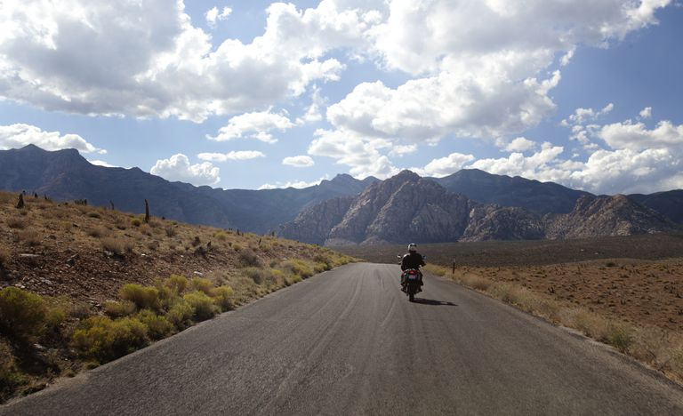 solo rider on long road