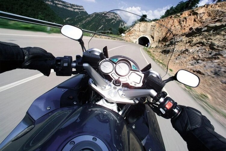 motorcycle point of view entering tunnel