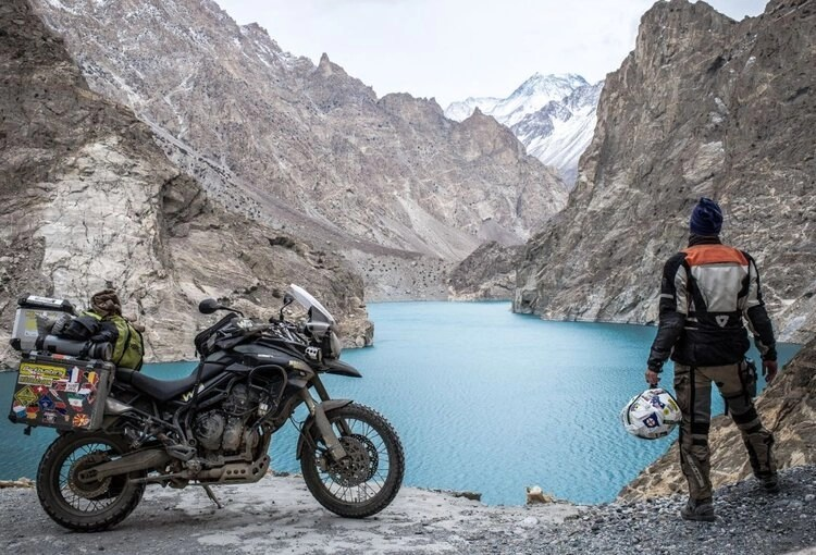 motorcyclist by lake - motorcycle travel