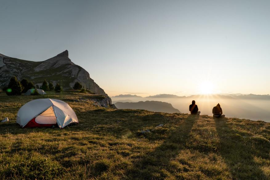 tent in the mountains at sunrise - motorcycle camping