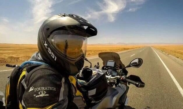 long straight road - listening to music while riding a motorcycle