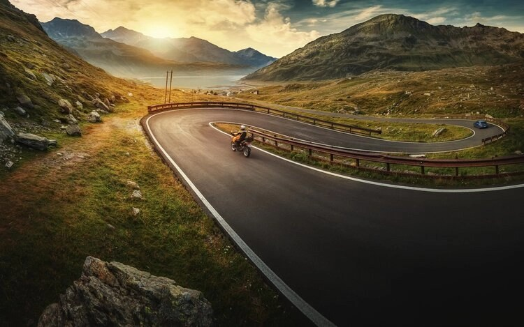 motorcycle winding road at sunrise