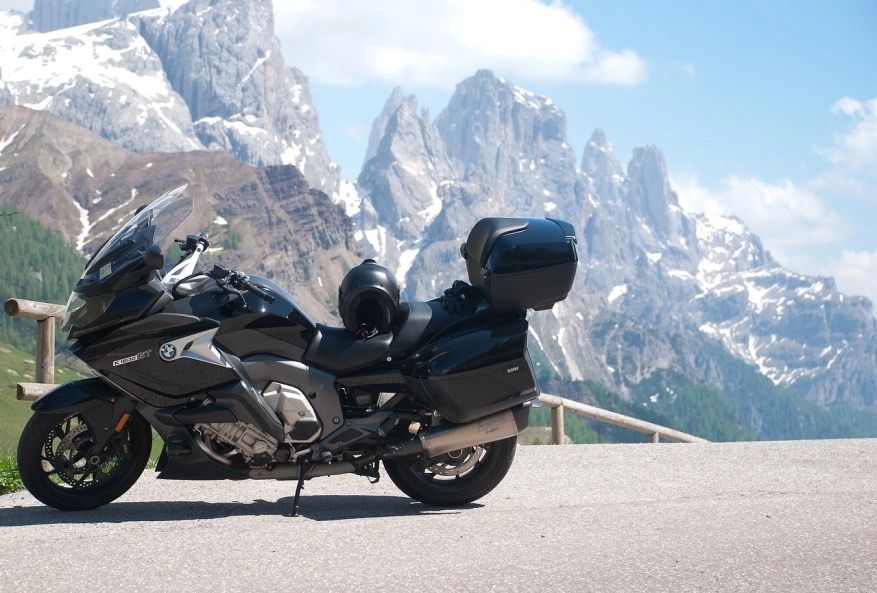 biker on mountain road - motorcycle touring style