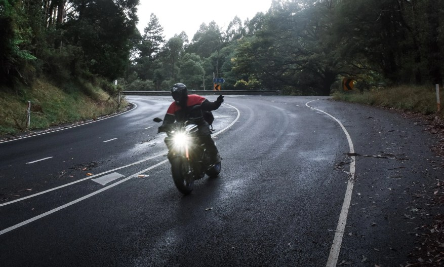 motorcyclist waving