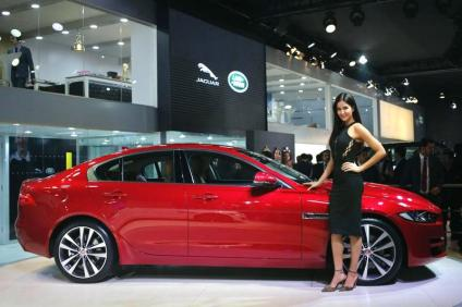 Bollywood actress Katrina Kaif poses with the Jaguar XE during its launch at the Indian Auto Expo in Greater Noida