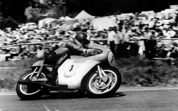 (Files) A picture taken on July 4, 1971 shows 500cc Motorcycle World Champion Giacomo Agostini from Italy riding his Agusta 500cc  in Spa Francorchamps where he won the 4th Belgium Grand Prix.  (Photo credit should read -/AFP/Getty Images)